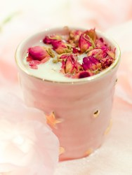 a rose moon milk with rose petals in a pink mug with gold stars on