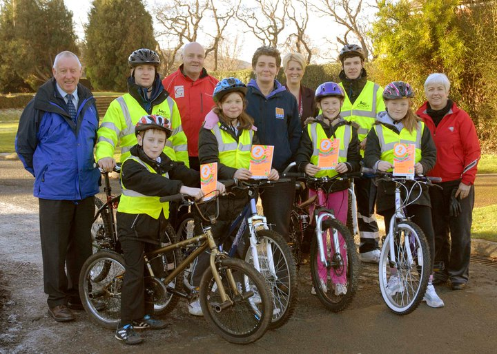 Photo of Gwenda with group of children on cycling scheme