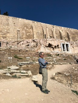 Joe looking in to the Theatre of Dionysus with one of the old gates accessing the caves in the wall.