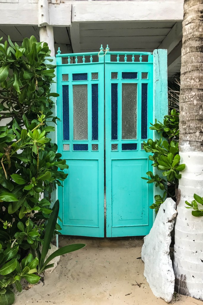 Hacienda blue French doors in Tulum Mexico