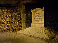 Plaque commemorating 10 August 1792 assault on the Tuileries, in the Catacombs of Paris where many of those killed have been buried. Courtesy of Wikipedia.