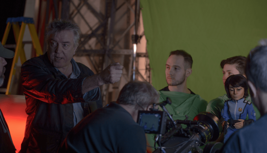 Director Steve Begg working with the puppeteers on Firestorm