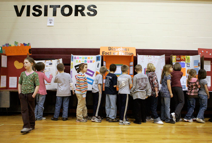 Tri Elementary students walk through the gym and look and their classmates science fair projects. (C-T photo Max Gersh)