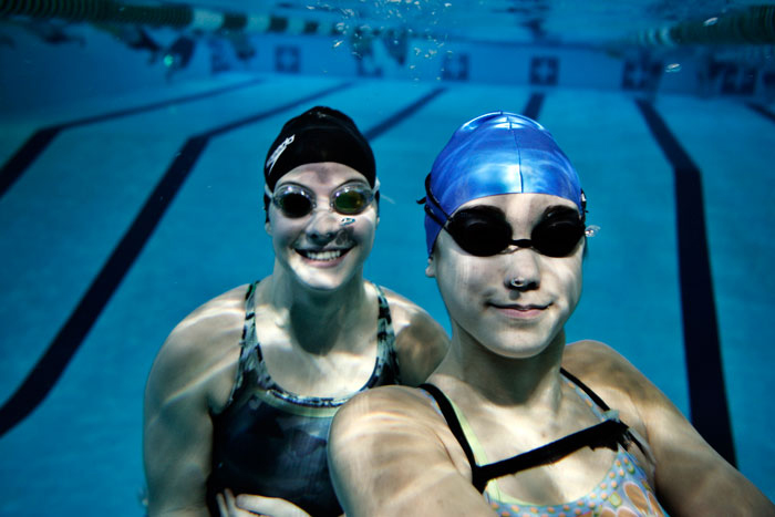 New Castle swimmers Aimee Haddix, left, and Hannah Espiritu pose for an underwater photo at Parkview Pool. The two swimmers are competing in today's state final. (C-T photo Max Gersh) ©2010