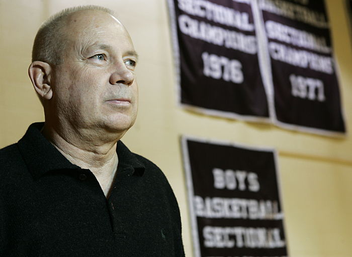 Former Tri coach Don Schwarzkopf looks out at the high school basketball court with three sectional championship banners hanging in the background. Schwarzkopf won all three of the titles. (C-T photo Max Gersh) ©2010
