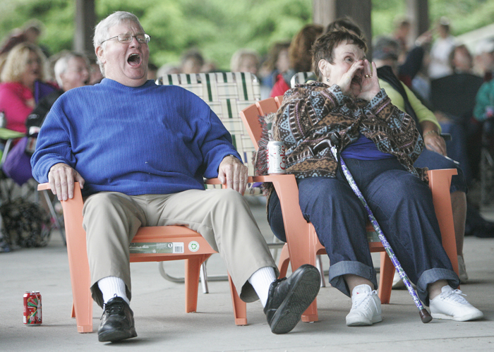 "Dan, left, and Beth Conway of New Castle sing along at the Duke Tumatoe concert Friday night at the Arts Park. Tumatoe repeatedly yelled ""Let's get loose"" and requested that the crowd respond by yelling ""Loose"" back. (C-T photo Max Gersh) ©2010"