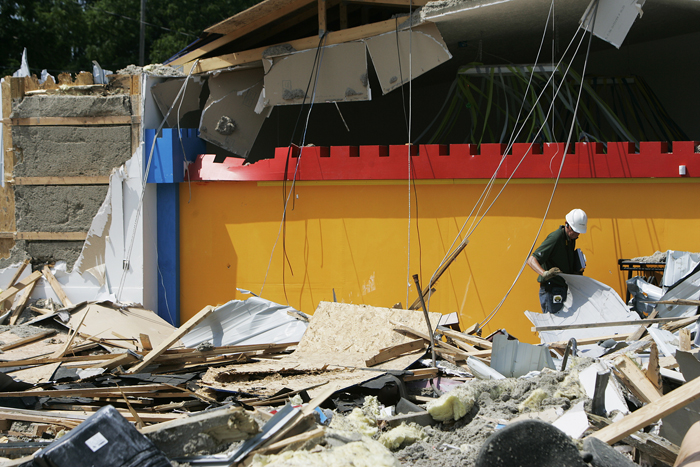 An Indianapolis based civil engineer searches through rubble at the site where Big Bounce Inflatables collapsed Thursday afternoon. He said that it is difficult to distinguish what damage was done during the collapse from what was done by bulldozers. (C-T photo Max Gersh) ©2010