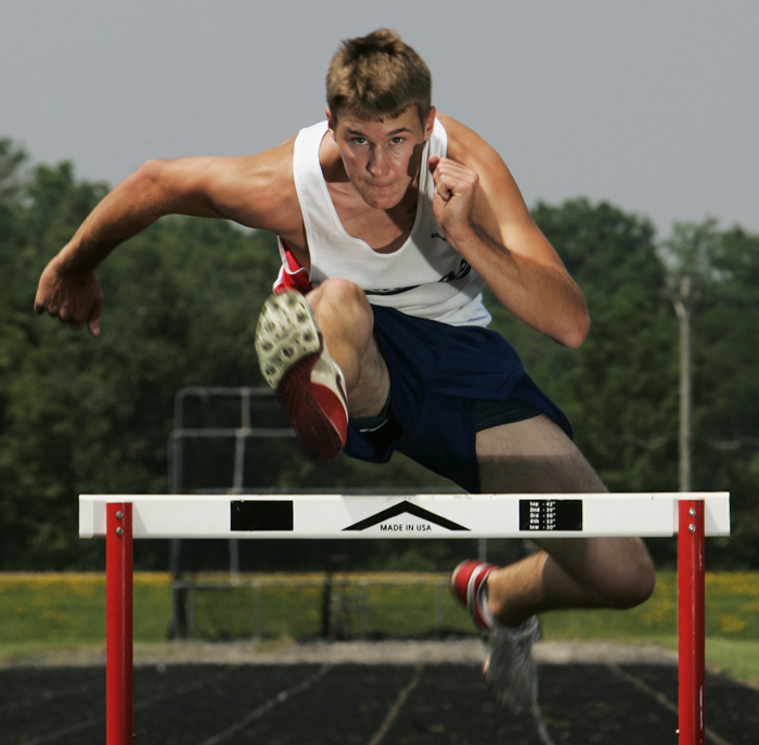 Blue River Valley's J.T. Griggs leaps a hurdle June 25 at the BRV track. Griggs won three events in the Henry County track meet this year. ©2010