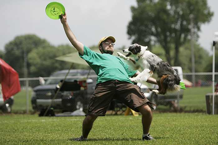 Matt Bilderback of Columbus, Ohio competes in the expert freestyle event with his dog, Bella, at the Skyhoundz North Central Regional championship in Osborne Park. (C-T photo Max Gersh) ©2010