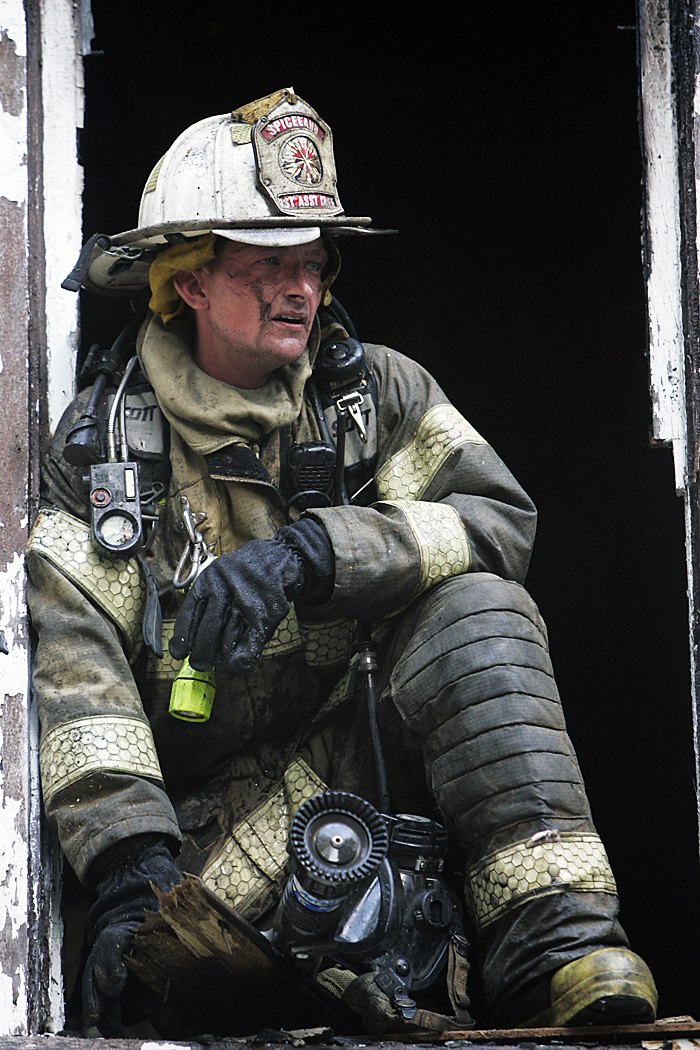 Joey Cunningham, assistant fire chief at the Spiceland Volunteer Fire Department, looks out a second story window Thursday afternoon after extinguishing a house fire in Spiceland. (C-T photo Max Gersh) ©2010
