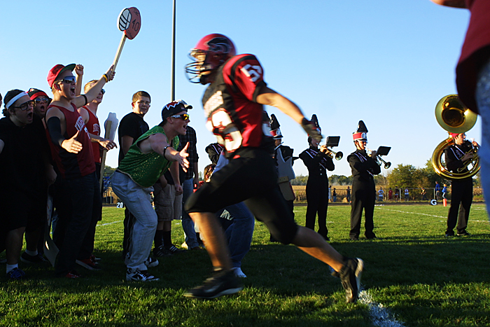 Knightstown's Jordan Jessup runs through a tunnel of fans at the beginning of the Panthers' game agaisnt Eastern Hancock. (C-T photo Max Gersh) ©2010