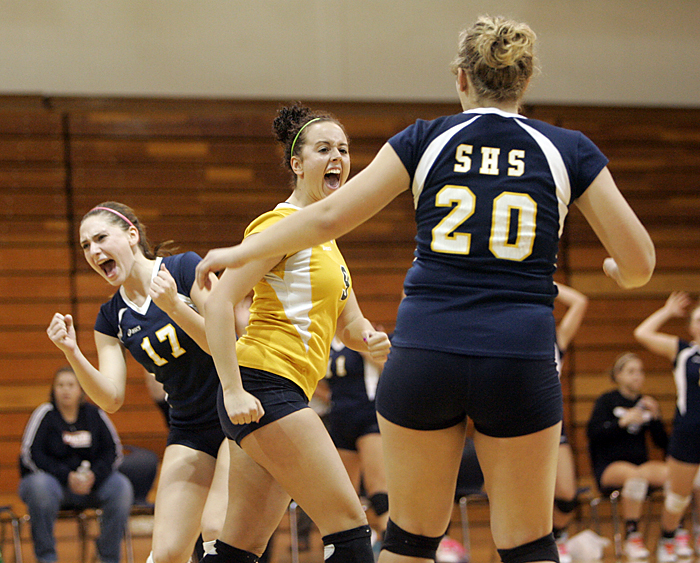 From left, Shenandoah's Kirstyn Pierce, Kenzie Cox and Adrianne Trennephol celebrate after a point Tuesday night in a regional match against Muncie Burris. (C-T photo Max Gersh) ©2010