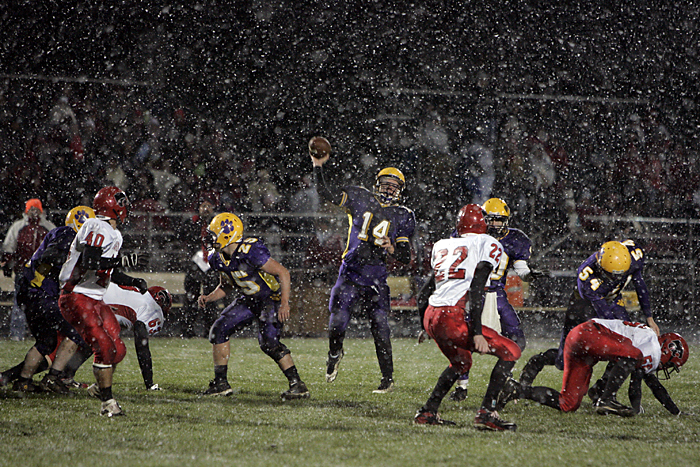 Hagerstown quarterback Alex Houck throws a pass Friday night during the sectional championship game against Knightstown. (C-T photo Max Gersh) ©2010