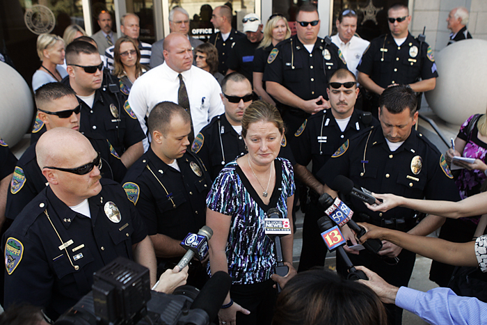 Lesley Phillips, wife of fomer Greenfield officer Will Phillips, speaks to the media Tuesday afternoon outside of the Henry County Justice Center. Phillips' husband was killed when a vehicle driven by Sue Ann Vanderbeck hit him while he was riding a bicycle during a police exercise in Knightstown on Sept. 30. (C-T photo Max Gersh) ©2010