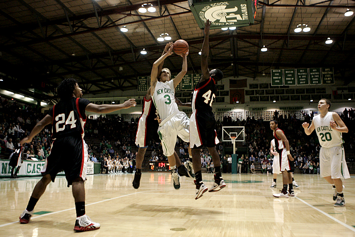 New Castle's Jordan Hahn puts up a shot against the Muncie South defense Friday night in the Fieldhouse. (C-T photo Max Gersh) ©2010