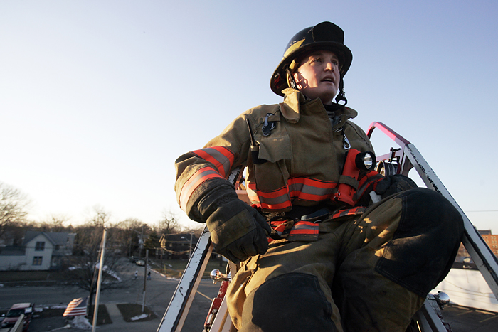 MAX GERSH | ROCKFORD REGISTER STAR ©2011 Firefighter Marcus Owens trains on an extended ladder truck Thursday, Jan. 6, 2011, at fire station 2 in Rockford.