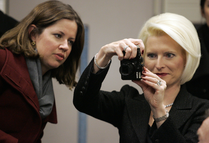MAX GERSH | ROCKOFRD REGISTER STAR Callista Gingrich (right) takes a photo of her husband, former Speaker of the House Newt Gingrich, Friday, Feb. 4, 2011, while Alicia Melvin watches. Gingrich was in town to participate in the Ronald Reagan centennial celebration. ©2011