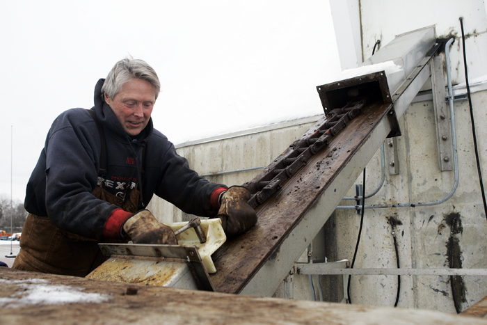 MAX GERSH | ROCKFORD REGISTER STAR Randy Dimmel, a property maintenance repair man for the City of Rockford, makes repairs to a salt dome elevator Monday, Jan. 31, 2011,at the Rockford City Yard. ©2011