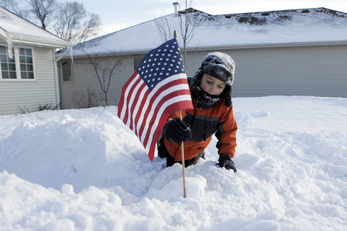 MAX GERSH | ROCKFORD REGISTER STAR Mason Caltagerone, 4, places a flag on top of a snow fort Wednesday, Feb. 2, 2011,  in front of his family's home on Ann's Acres in Rockford. ©2011