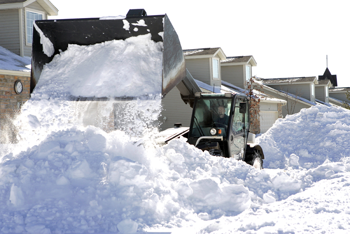 MAX GERSH | ROCKFORD REGISTER STAR Dave Stracka of the Cherry Valley Landscape Center uses a loader to clear out residential driveways Thursday, Feb. 3, 2011, on Trowbridge Lane in Rockford. ©2011