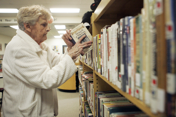 MAX GERSH | ROCKFORD REGISTER STAR Library aide Edie Matheson returns a book to a shelf Tuesday, March 1, 2011, in the childrens section of the Pecatonica Library. ©2011