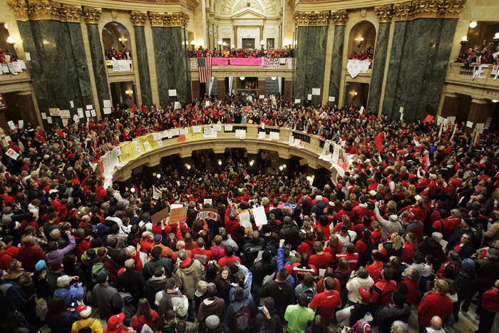 MAX GERSH | ROCKFORD REGISTER STAR  People fill the state Capitol Friday, Feb. 18, 2011, in Madison, Wis., to protest Gov. Scott Walker's bill to eliminate collective bargaining rights for state workers. ©2011