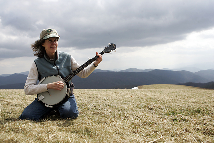 Gavin's aunt smoking the strings on my banjo at Max Patch in North Carolina. ©2011 Max Gersh