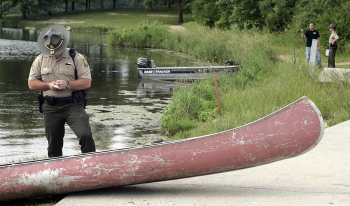 MAX GERSH | ROCKFORD REGISTER STAR A conservation officer looks at a canoe Tuesday, June 14, 2011, at a boat dock in Rock Cut State Park in Loves Park. A 17-year-old boy that was pulled from the water had been riding in the canoe. ©2011