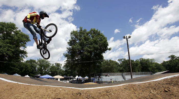 MAX GERSH | ROCKFORD REGISTER STAR Trever White, 15, of Aberdeen, S.D., catches air Thursday, June 16, 2011, during practice runs for the ABA BMX Midwest Nationals at Searls Park in Rockford. ©2011