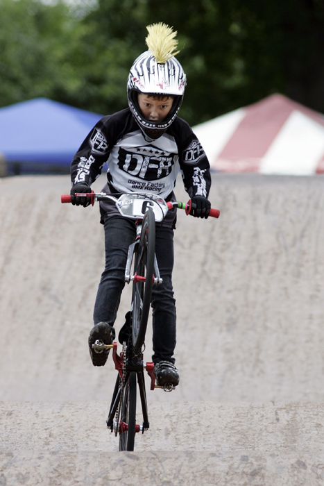 MAX GERSH | ROCKFORD REGISTER STAR Henry Chudzik, 7, of Chicago rides the final section of the track Thursday, June 16, 2011, during practice runs for the ABA BMX Midwest Nationals at Searls Park in Rockford. ©2011