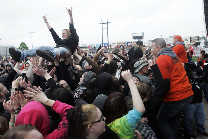 MAX GERSH | ROCKFORD REGISTER STAR Security crews prepare to remove a crowd surfer Saturday, May 14, 2011, during the The Concert at Rockford Speedway in Loves Park. ©2011