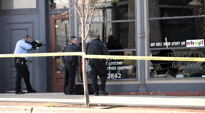 MAX GERSH | ROCKFORD REGISTER STAR Rockford police move in to CD Source to kill a deer Friday, Oct. 28, 2011, in Downtown Rockford. The deer crashed through on of the stores front windows earlier in the morning. © 2011