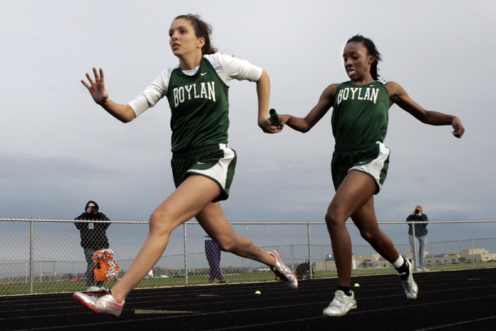 MAX GERSH | ROCKFORD REGISTER STAR Boylan's Eleyia Manns (right) hands the baton to Bryn Bauling during the 4x100 meter relay Thursday, May 5, 2011, during the NIC-10 girls championship meet at Belvidere North High School. © 2011