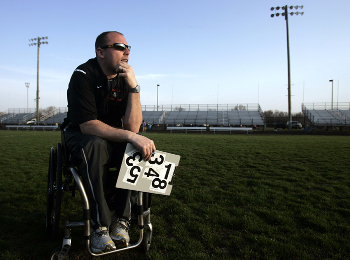 MAX GERSH   ROCKFORD REGISTER STAR Harlem High School Assistant Track Coach Kelsey Lueshen watches a race Wednesday, April 13, 2011, from the infield at Hononegah High School in Rockton. ©2011