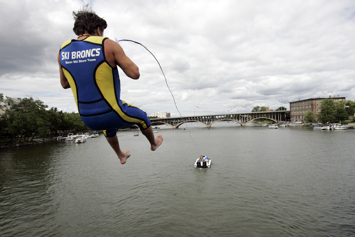 MAX GERSH | ROCKFORD REGISTER STAR Ski Broncs performer Tyler Smith leaps off a tower on the State Street Bridge while being pulled by a boat Sunday, Sept. 4, 2011, during On the Waterfront in downtown Rockford. ©2011