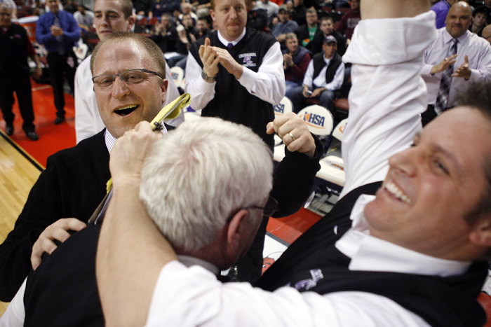 MAX GERSH | ROCKFORD REGISTER STAR Lutheran head coach Tom Guse (from left) celebrates with assistant coaches Jerry Guse and Dean Martineiti Saturday, March 10, 2012, after defeating Seaton Academy in the Class 2A third place game at the Peoria Civic Center. ©2012