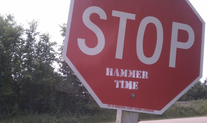 "A ""hammer time"" stamp on a stop sign in rural Winnebago County. Shot using the stock camera on a Droid Incredible. ©2011 Max Gersh"
