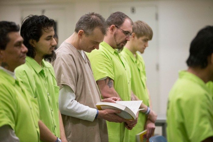 James Moore follows along with the service Sunday, March 27, 2016, during Easter Mass at the Winnebago County Jail in Rockford. MAX GERSH/STAFF PHOTOGRAPHER/RRSTAR.COM ©2016