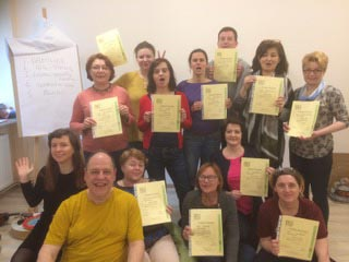 Jon Blend and training group holding certificates