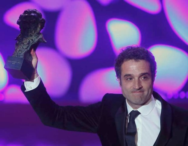 Guzman reacts as he holds his Best News Director Award during the Spanish Film Academy's Goya Awards ceremony in Madrid