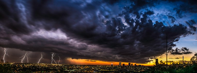 I took this image from Observatory Ridge- the highest point in Johannesburg. It is a panoramic shot comprised of two sections, namely: The lightning section, which contains images blended into one shot to capture as many lightning strikes as possible, and the cityscape. I felt extremely lucky to have been in the right place at the right time to capture such an impressive storm and sunset over my hometown. - By Greg Giessing, Johannesburg Nikon D7100, Nikon 17-55mm f/2.8, ISO 100, f/11, 10 Secs (Lightning Shots) / 5 Secs (Cityscape)