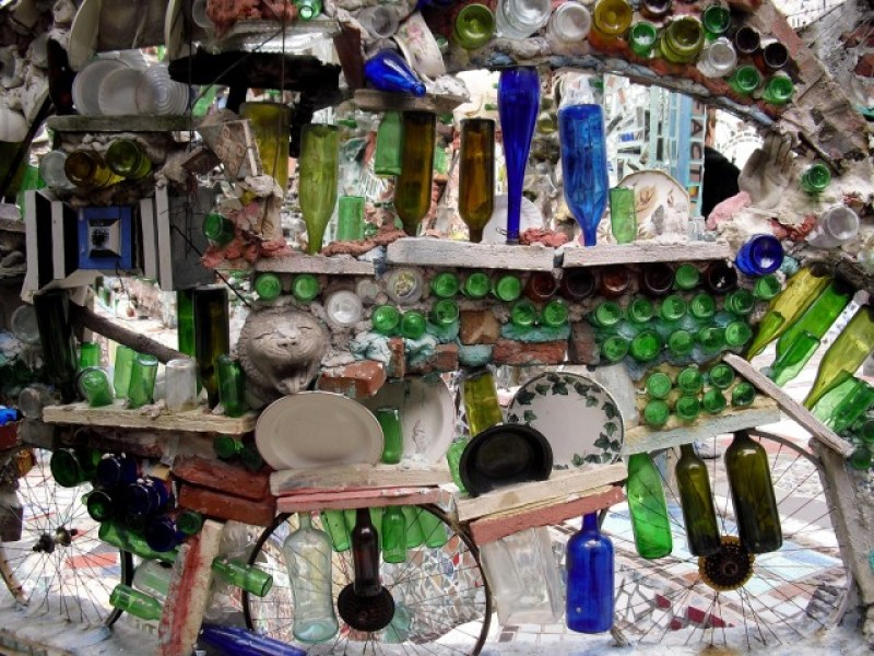 Colorful pieces of plates, bottles and glass objects form a 3-D mural in Philadelphia, PA #visitphilly #PATravelHappy @GetawayMavens