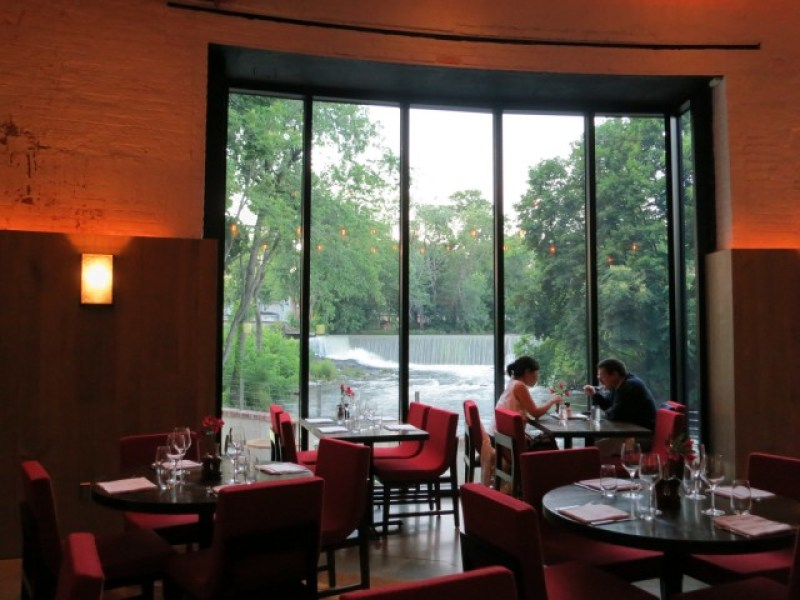Dining by window overlooking waterfall and Fishkill Creek, Beacon, NY