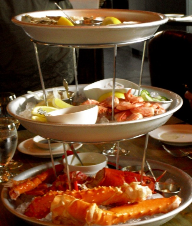Three tiers of seafood; lobster, shrimp, shellfish