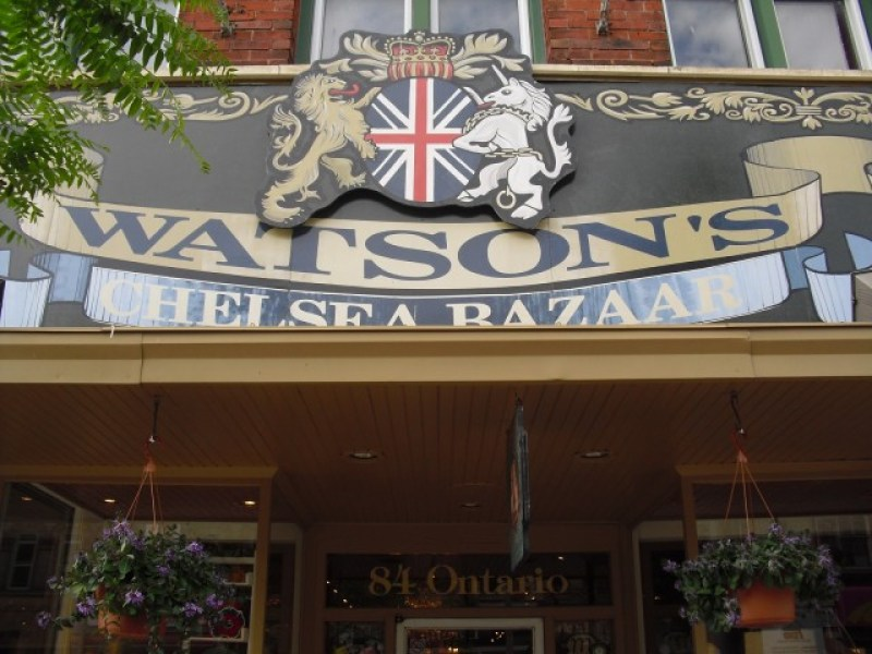 English sign with Brittish insignia over door of boutique giftwares shop