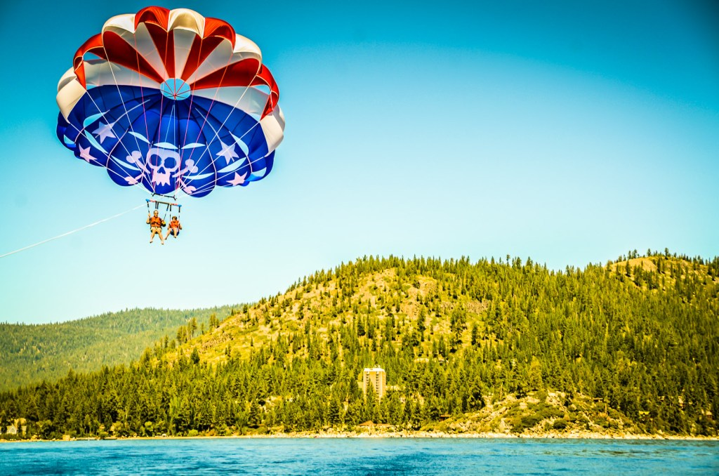 Mother and child parasail over Lake Tahoe.