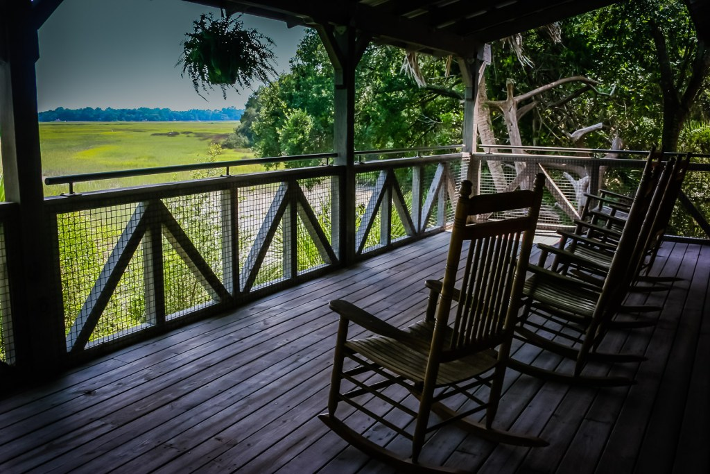 Rocking chairs on front porch at Sapelo Island Visitors Center, Georgia.