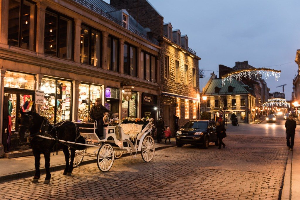 A white carriage awaits visitors on the 17th century cobble-stone streets of Old Montreal.
