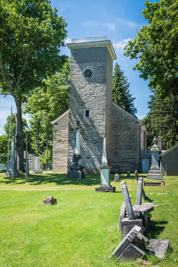 The Old Stone Fort Museum Tower overlooking cemetery in Schoharie NY.