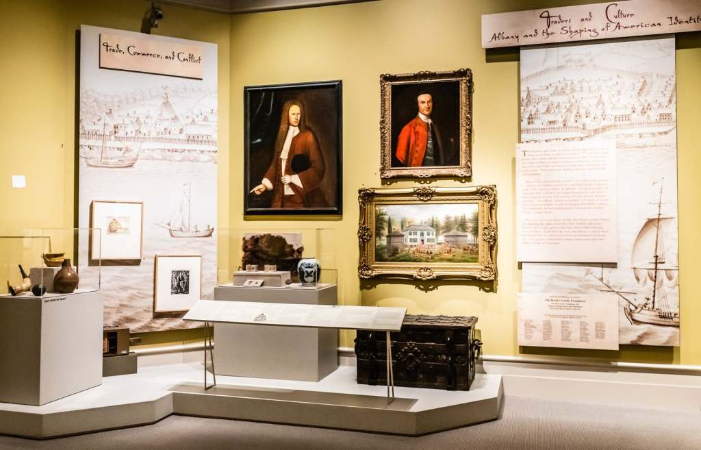 Historical artifacts and portraits on display in exhibit on European settlement in Albany, New York on permanent display at the Albany Institute of History and Art.